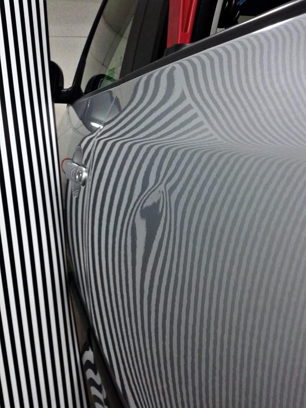 Naprawa wgnieceń w karoseii samochodu 16