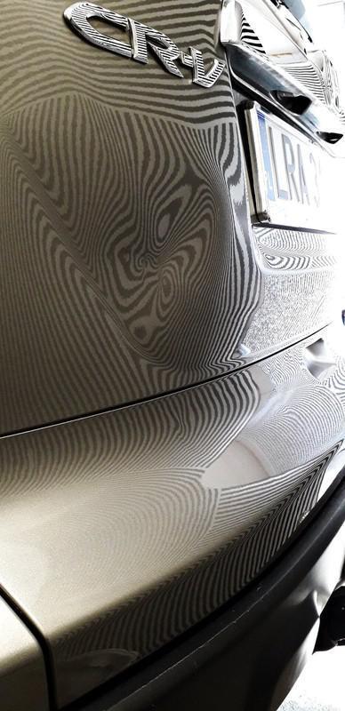 Naprawa wgnieceń w karoseii samochodu 34